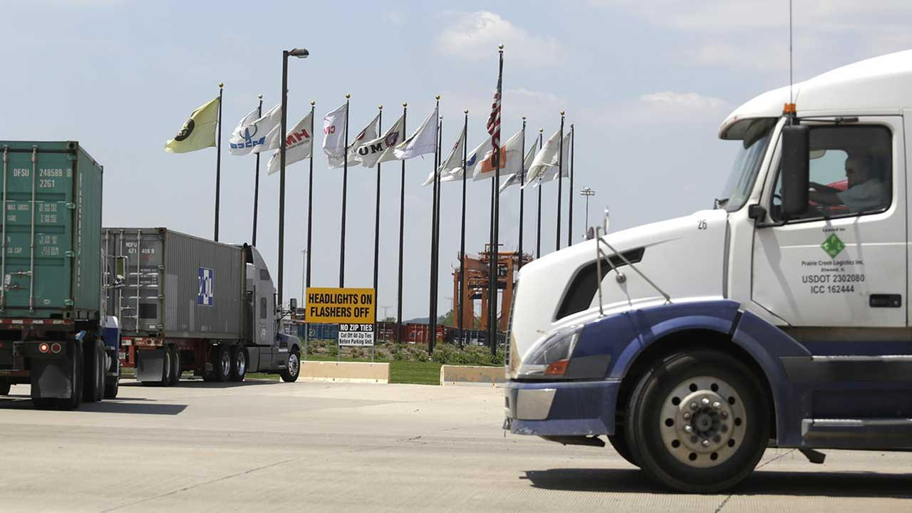 (FILE) This May 23, 2014 photo shows trucks traveling through Center Point Intermodal Center outside Elwood, Ill., south of Joliet.