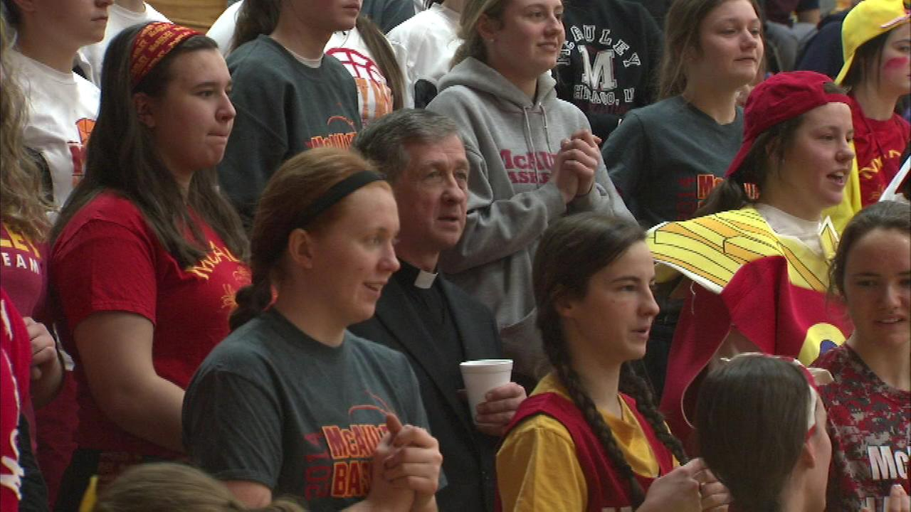 Archbishop Blase Cupich attended the basketball game between Mother McAuley and Resurrection high schools Tuesday night as part of Catholic Schools Week.
