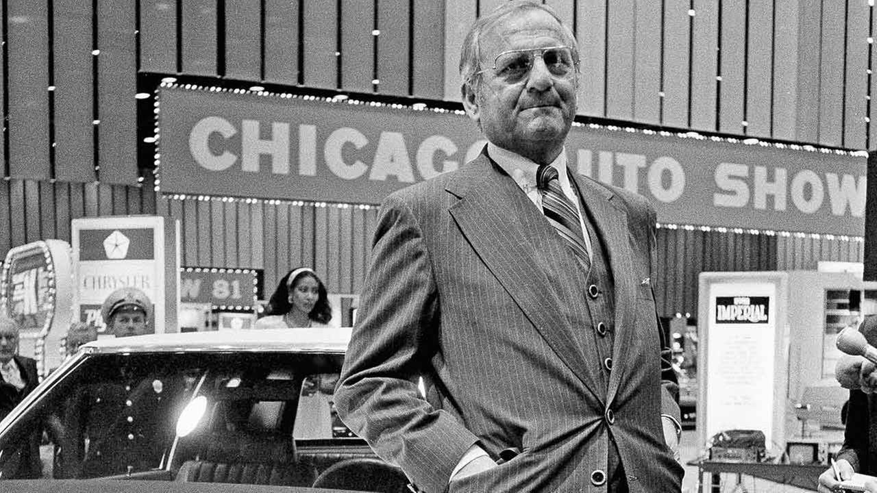 Chrysler Chairman Lee Iacocca stands with one of the companys popular K cars at the Chicago Auto Show on Friday, Feb. 20, 1981 in Chicago.AP Photo