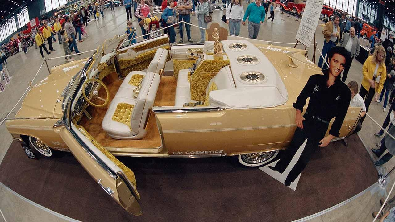 Crowds at an auto show in Chicago on Jan. 17, 1987, to look at a custom-made 1965 gold Cadillac Eldorado designed by George Barris and Elvis Presley.AP Photo/John Swart