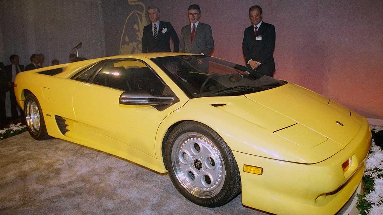 Chrysler and Lamborghini executives look over the new Lamborghini Diablo after it was unveiled at a preview for the upcoming Chicago Auto Show on Feb. 9, 1990.AP Photo/Jonathan Kirn