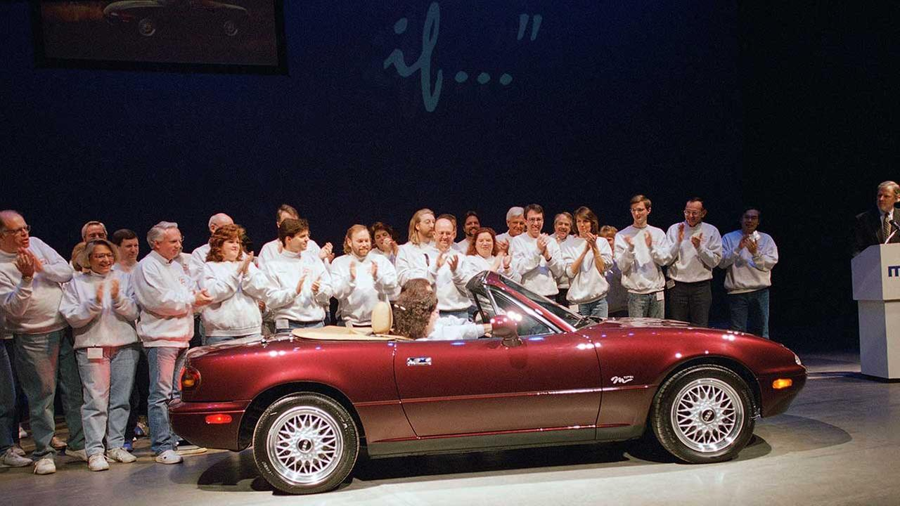 Members of the Miata Club of America applaud the Mazda Miata M Edition at the Chicago Auto Show on Feb. 10, 1995, in Chicago.AP Photo/Charles Bennett