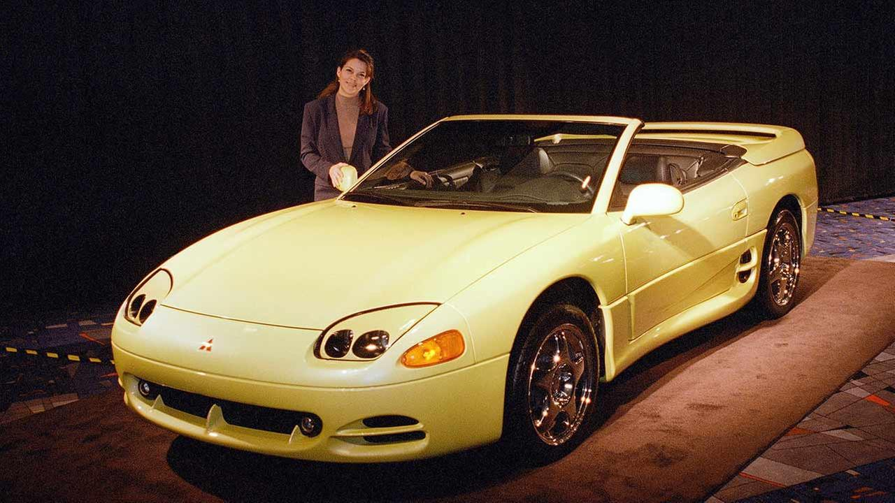 Yvette Hale poses with the 1995 Mitsubishi 3000 GT Spyder convertible at a Chicago Auto Show preview on Feb. 8, 1995 in Chicago.AP Photo/Charles Bennett
