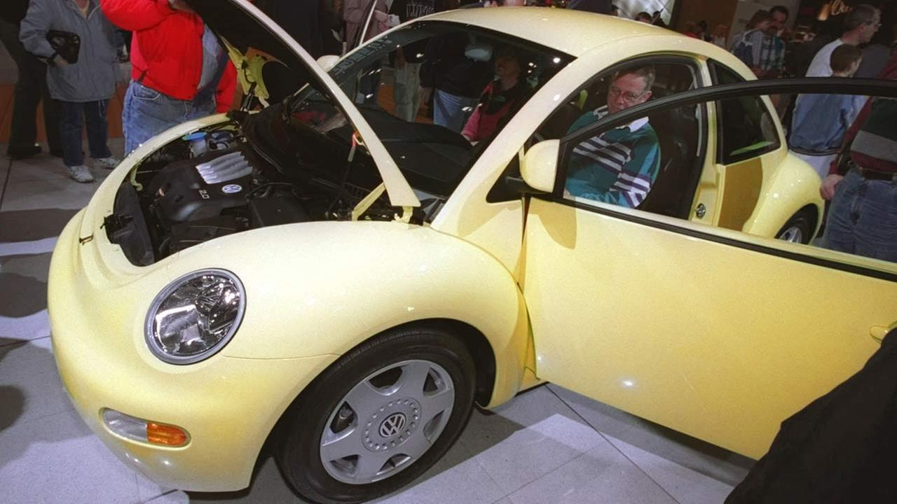 People attending the opening of the 90th edition of the Chicago Auto Show at McCormick Place South inspect the new Volkswagen on Feb. 7, 1998.AP Photo/Peter Barreras