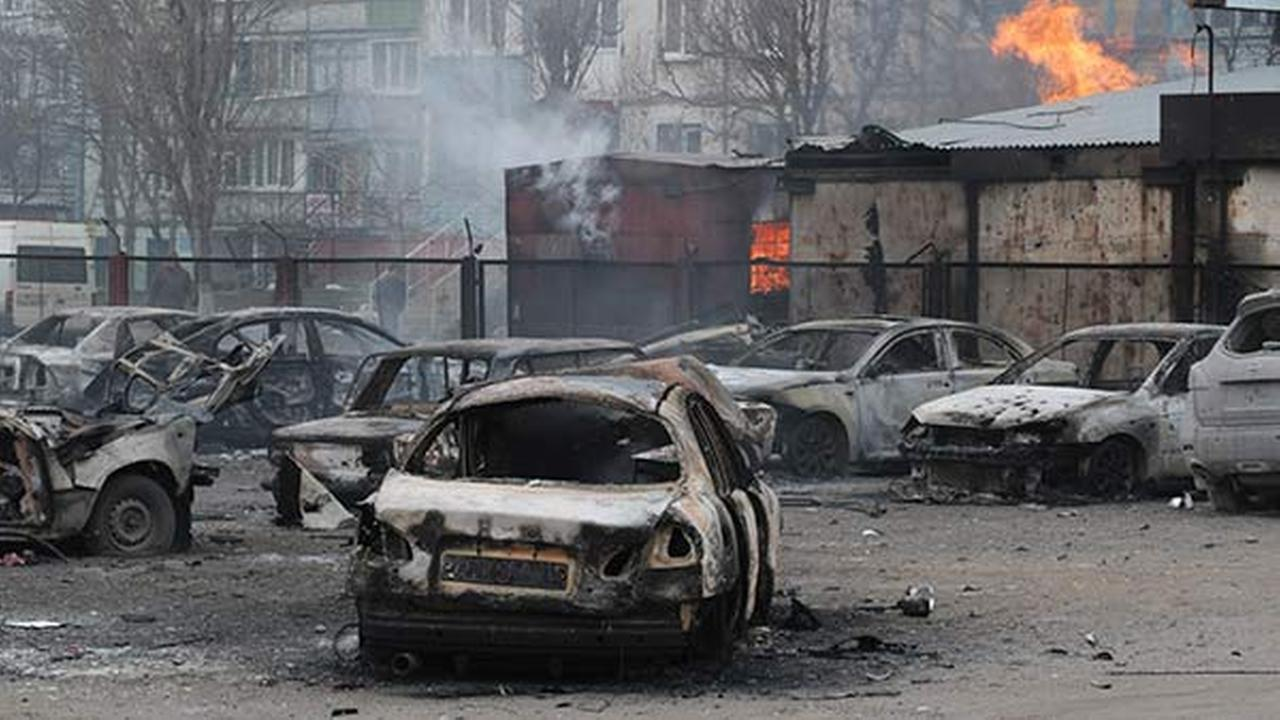 Burned cars on a destroyed parking site in a residential area in Mariupol, Ukraine, on Jan. 24, 2015.