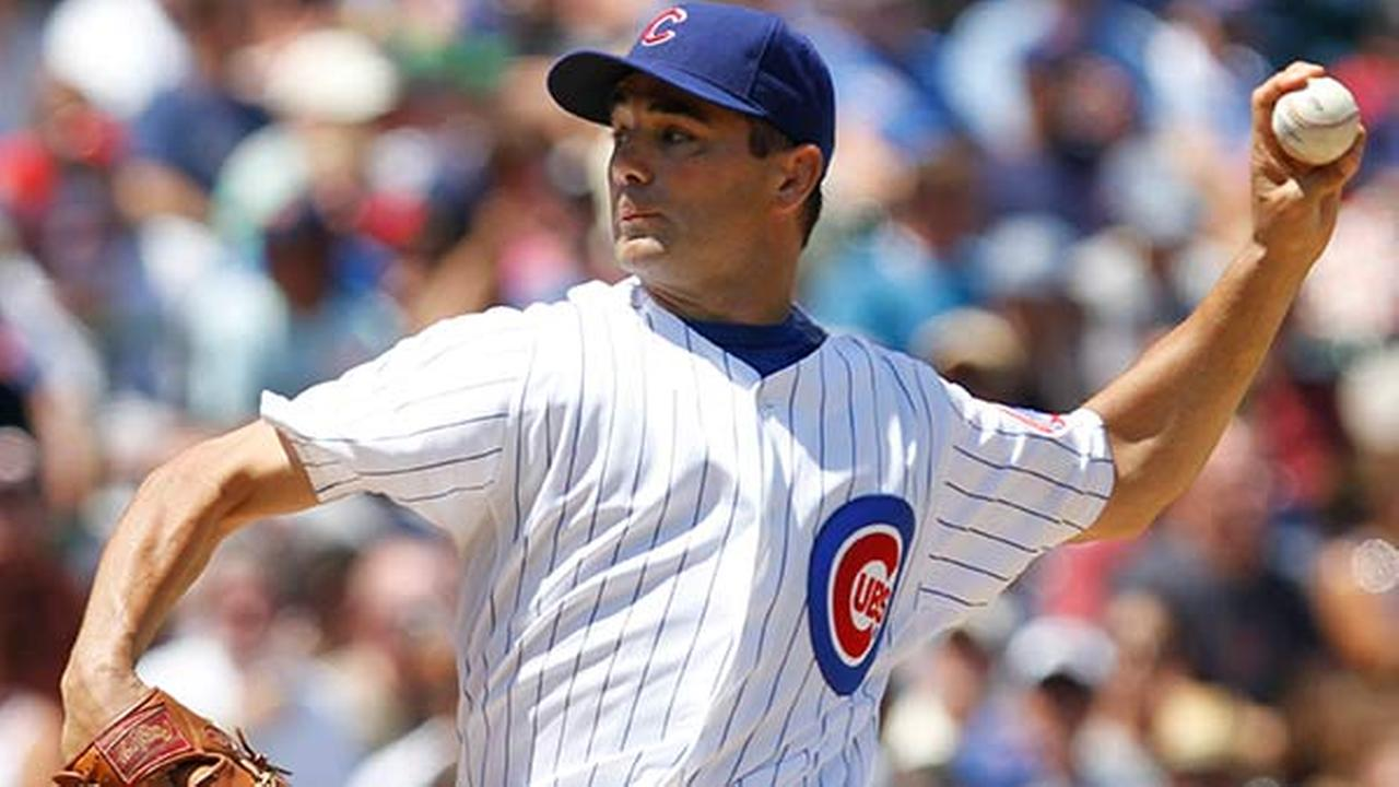 Former Chicago Cubs starter Ted Lilly delivers a pitch against the Philadelphia Phillies during the third inning of a baseball game on July 16, 2010, in Chicago.