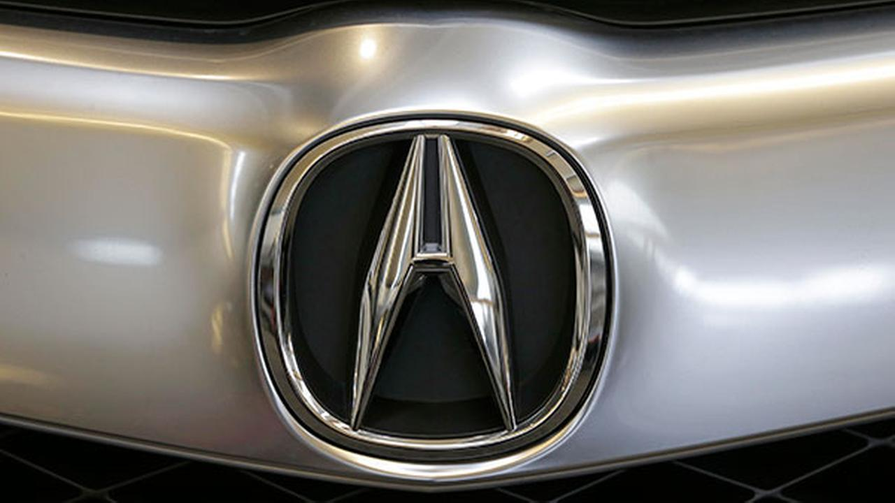 This Photo taken on Feb. 14, 2013 shows the Acura logo on the front of a 2013 Acura RDX on display at the 2013 Pittsburgh Auto Show in Pittsburgh.