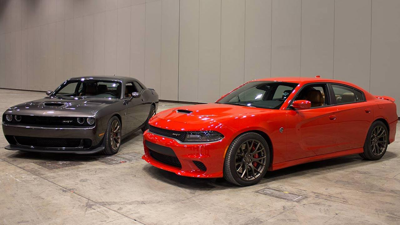The Dodge Challenger SRT Hellcat (left) and the Dodge Charger SRT Hellcat (right) during the Concept and Technology Garage event at the 2015 Chicago Auto Show on Feb. 11, 2015.