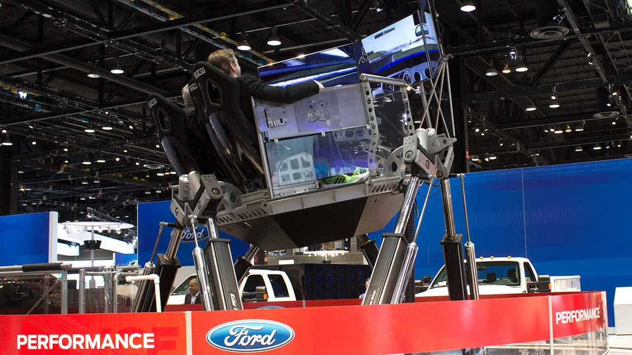 Fords Performance Simulator - a racing simulator that tests driving skills on a virtual road course - at the Chicago Auto Show on Feb. 12, 2015.