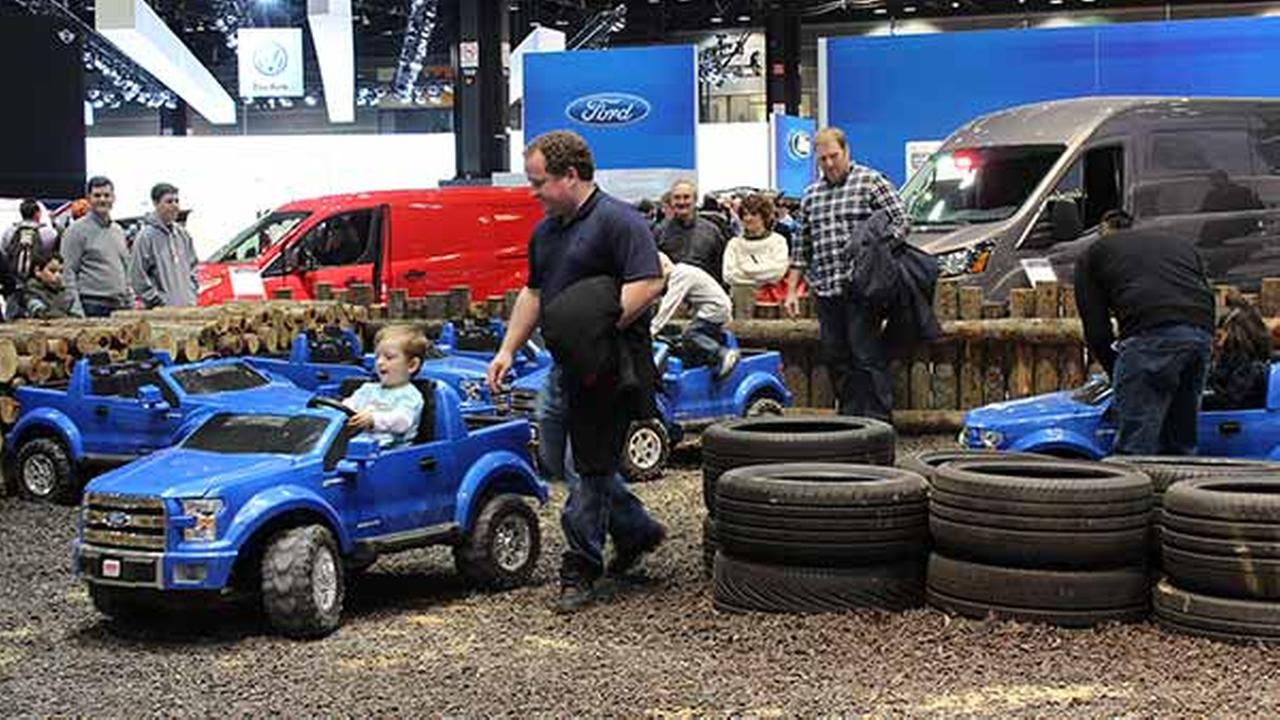 Children drive miniature Ford F-150 trucks as part of the companys display at the 2015 Chicago Auto Show on Feb. 14, 2015.