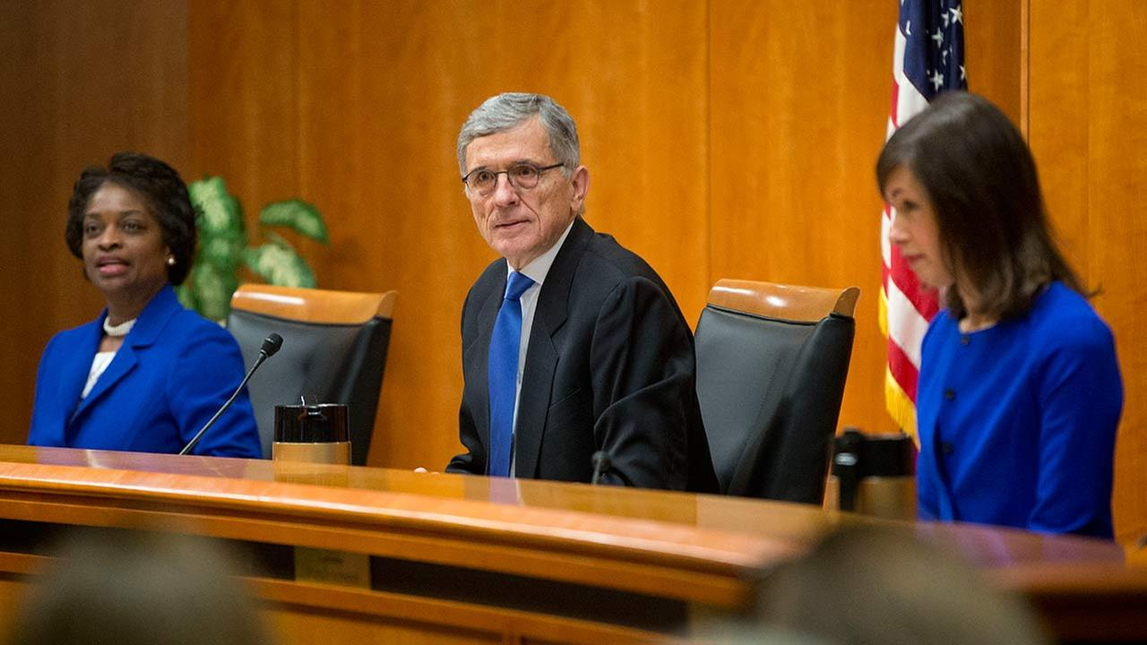 FCC Chairman Tom Wheeler, center, with FCC Commissioners Mignon Clyburn, left, and Jessica Rosenworcel, before the start of their open hearing in Washington on Feb. 26, 2015.