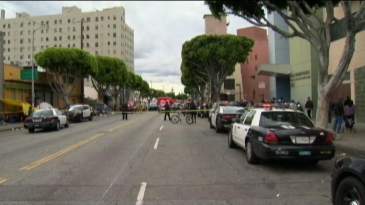 Los Angeles Police say officers shot and killed a man following a struggle on a sidewalk in the citys Skid Row area downtown.
