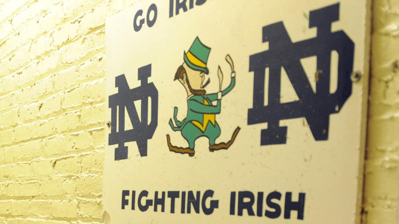 In this AP file photo, the hallway between the locker room and the field at Notre Dame stadium shows the sign Play like a Champion Today in South Bend, Ind.