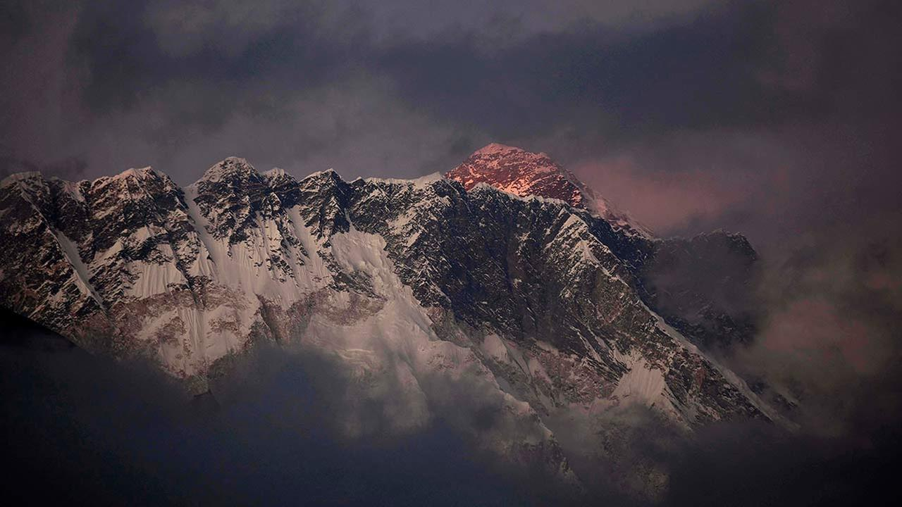 In this Oct. 27, 2011 file photo, the last light of the day sets on Mount Everest as it rises behind Mount Nuptse as seen from Tengboche, in the Himalayas Khumbu region, Nepal.