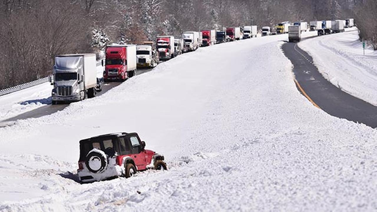A vehicle sits in the median of Interstate 24 as drivers wait after being stranded between Eddyville and Cadiz, Ky., Thursday, March 5, 2015.