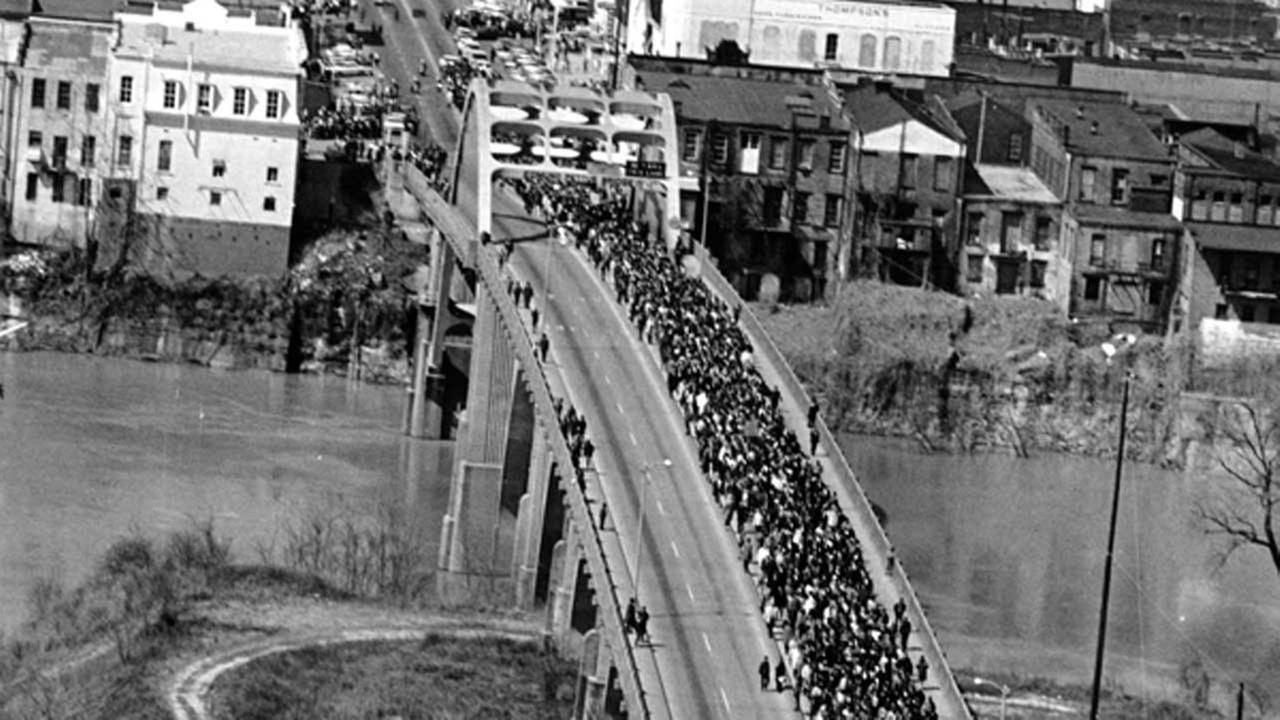 In this March 21, 1965 file photo, civil rights marchers cross the Alabama river on the Edmund Pettus Bridge in Selma, Ala. to the State Capitol of Montgomery.