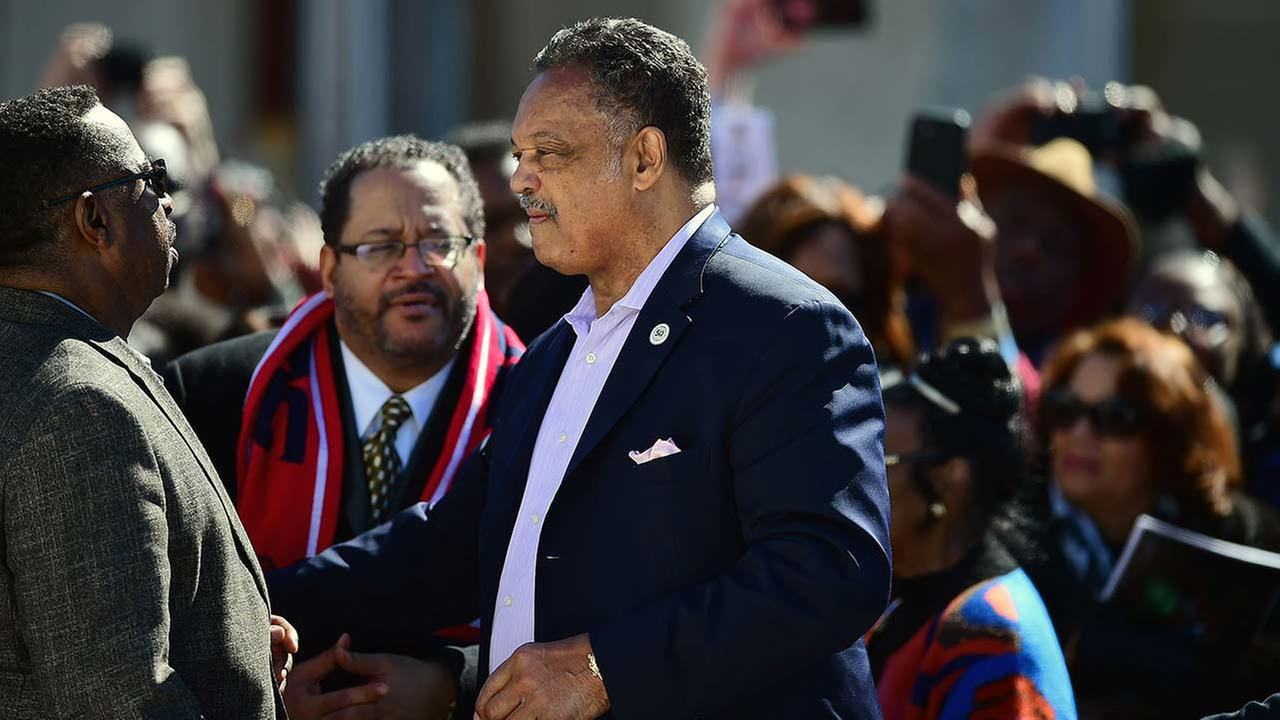 The Rev. Jesse Jackson speaks with people before President Barack Obama and others take a symbolic walk across the Edmund Pettus Bridge on March 7, 2015, in Selma, Ala.AP Photo/Bill Frakes