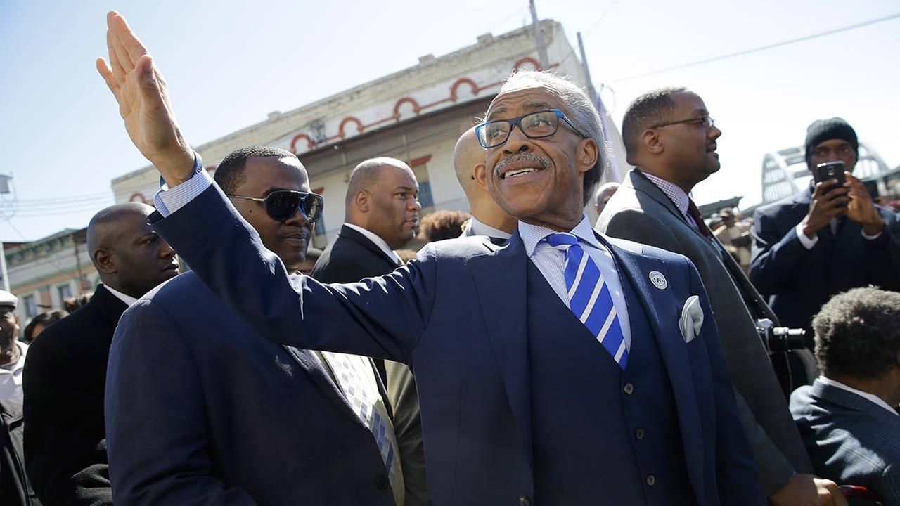 The Rev. Al Sharpton waves to supporters before President Barack Obama and others take a symbolic walk across the Edmund Pettus Bridge on March 7, 2015, in Selma, Ala.AP Photo/Gerald Herbert