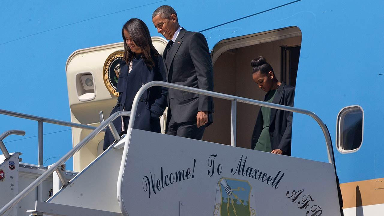President Barack Obama exits Air Force One with daughter Malia Obama, left, and Sasha Obama, on arrival at Maxwell Air Force Base in Montgomery, Ala.AP Photo/Jacquelyn Martin
