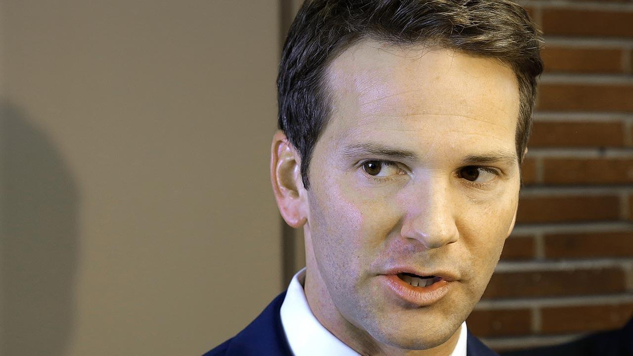 U.S. Rep. Aaron Schock speaks to reporters before meetings with constituents after a week in which he faced twin scandals on Feb. 6, 2015, in Peoria Ill.