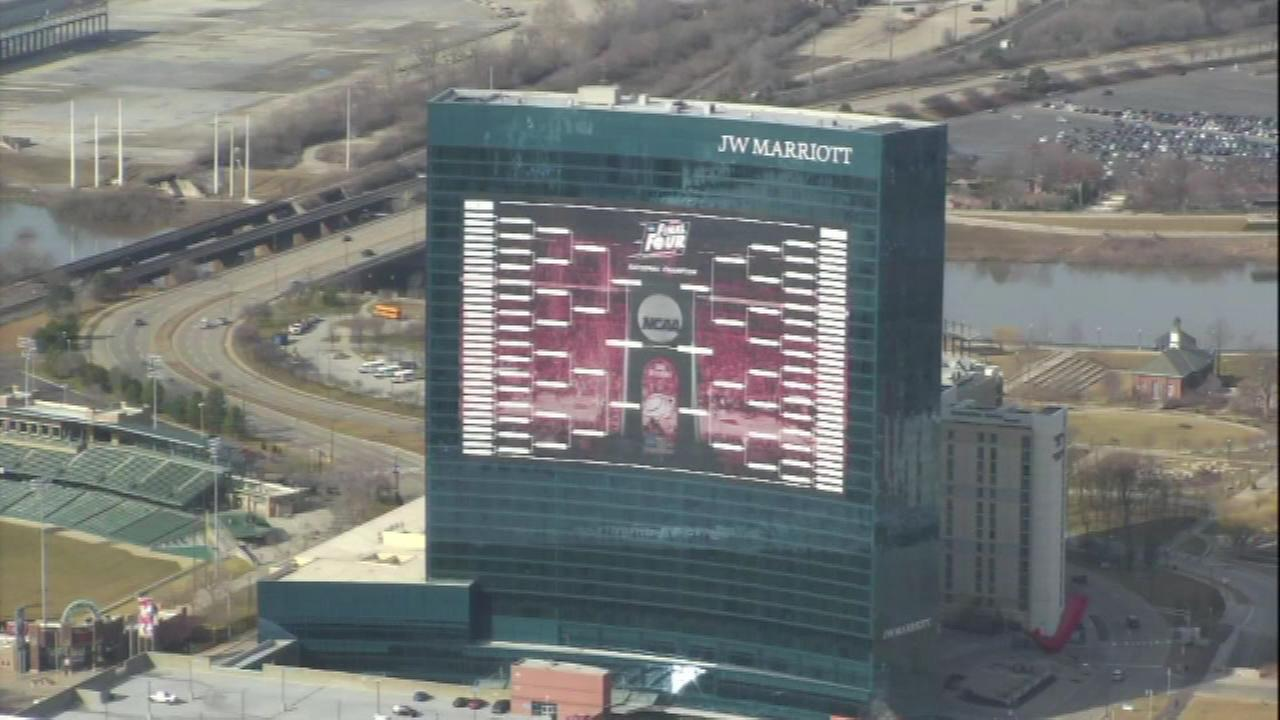 Throughout the NCAA March Madness tournament, crews will update a 16-story bracket on the side of the JW Marriott hotel in Indianapolis.