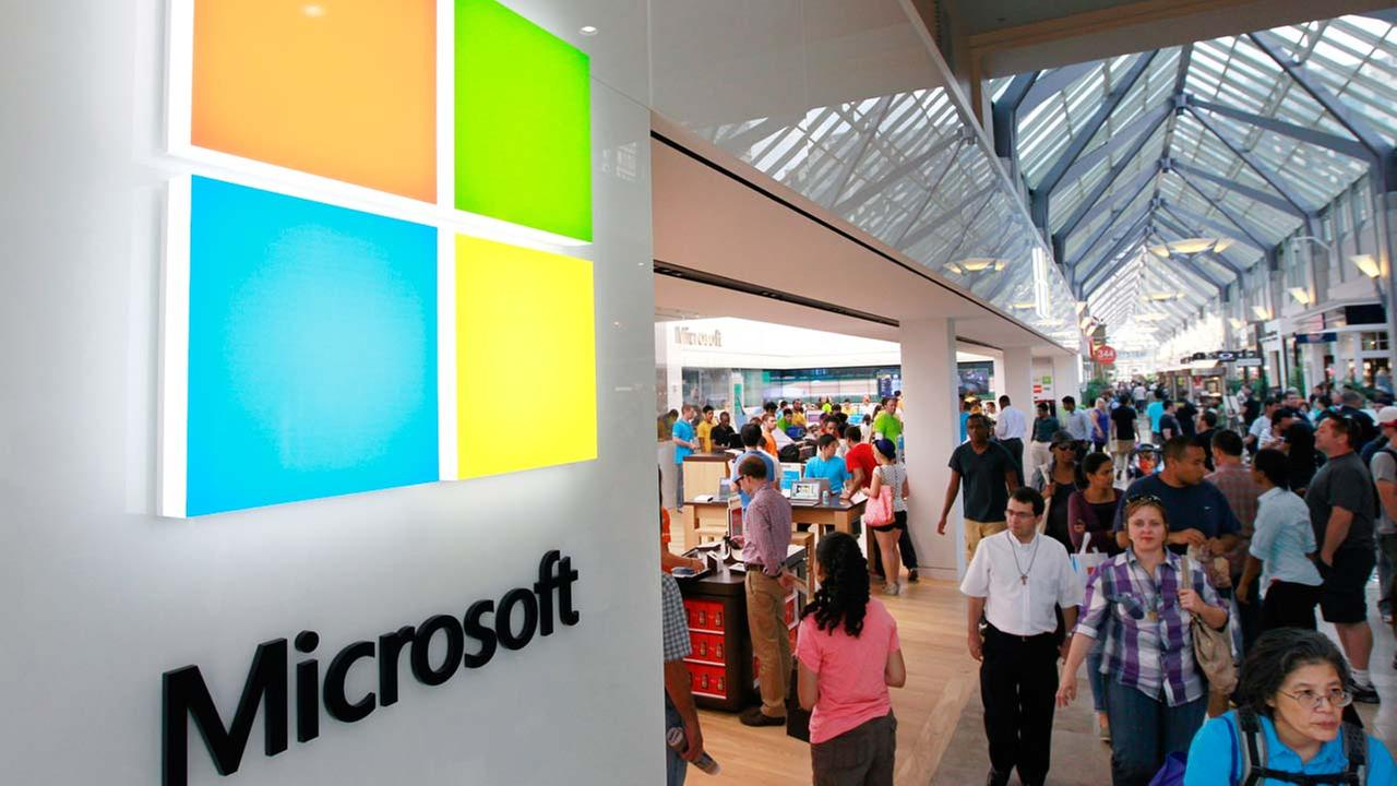 FILE: In this Thursday, Aug. 23, 2012 photo, the Microsoft Corp. logo, left, is seen on an exterior wall of a new Microsoft store inside the Prudential Center mall, in Boston