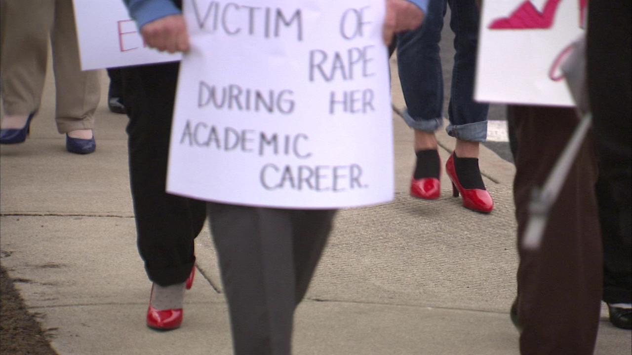 Men walk a mile in high heels promoting awareness of violence against women
