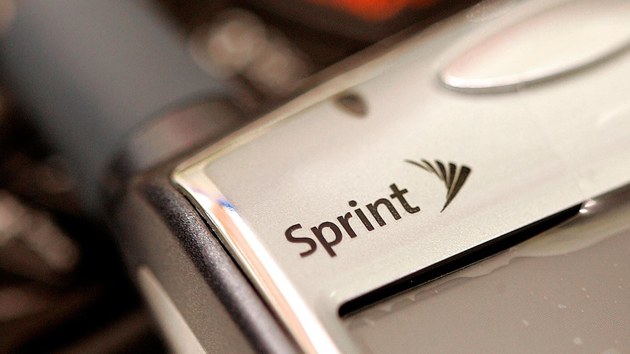 The new Sprint logo is seen on a phone on Oct. 25, 2005, at a Sprint Nextel store in Brookfield, Wis.