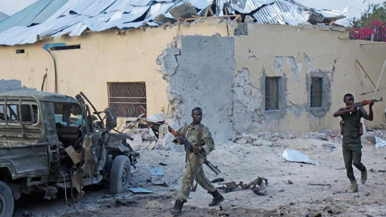 Somali soldiers take position after a bomb that was detonated at the gate of one of Mogadishus most popular hotel on March, 27, 2015.