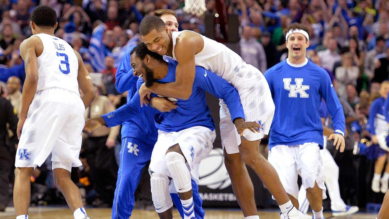 Kentucky players celebrate after a 68-66 win over Notre Dame in a college basketball game in the NCAA mens tournament regional finals, Saturday, March 28, 2015, in Cleveland.