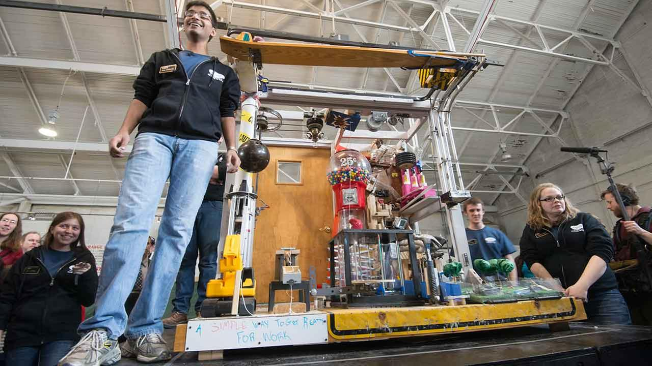 Adam Bahrainwala and the machine that won the Rube Goldberg Machine Contest.