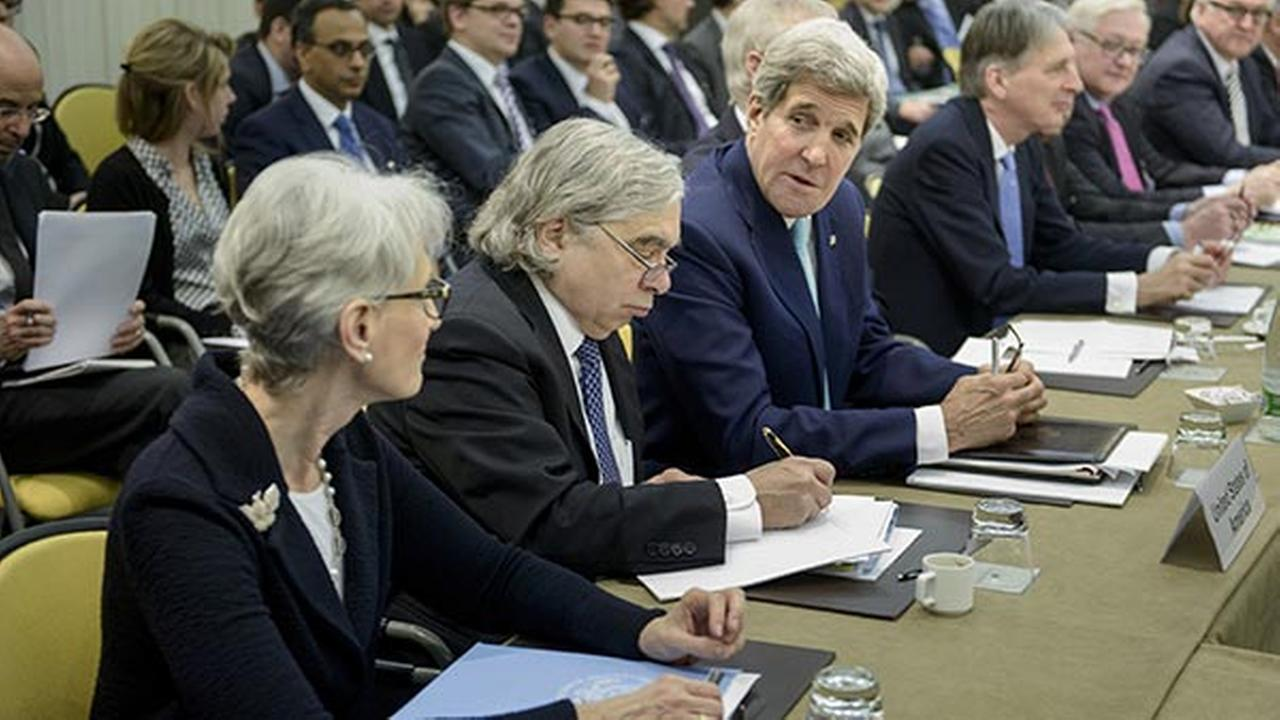 U.S. Secretary of State John Kerry chats with U.S. Under Secretary for Political Affairs Wendy Sherman before the start of a meeting on Irans nuclear program on March 31, 2015.