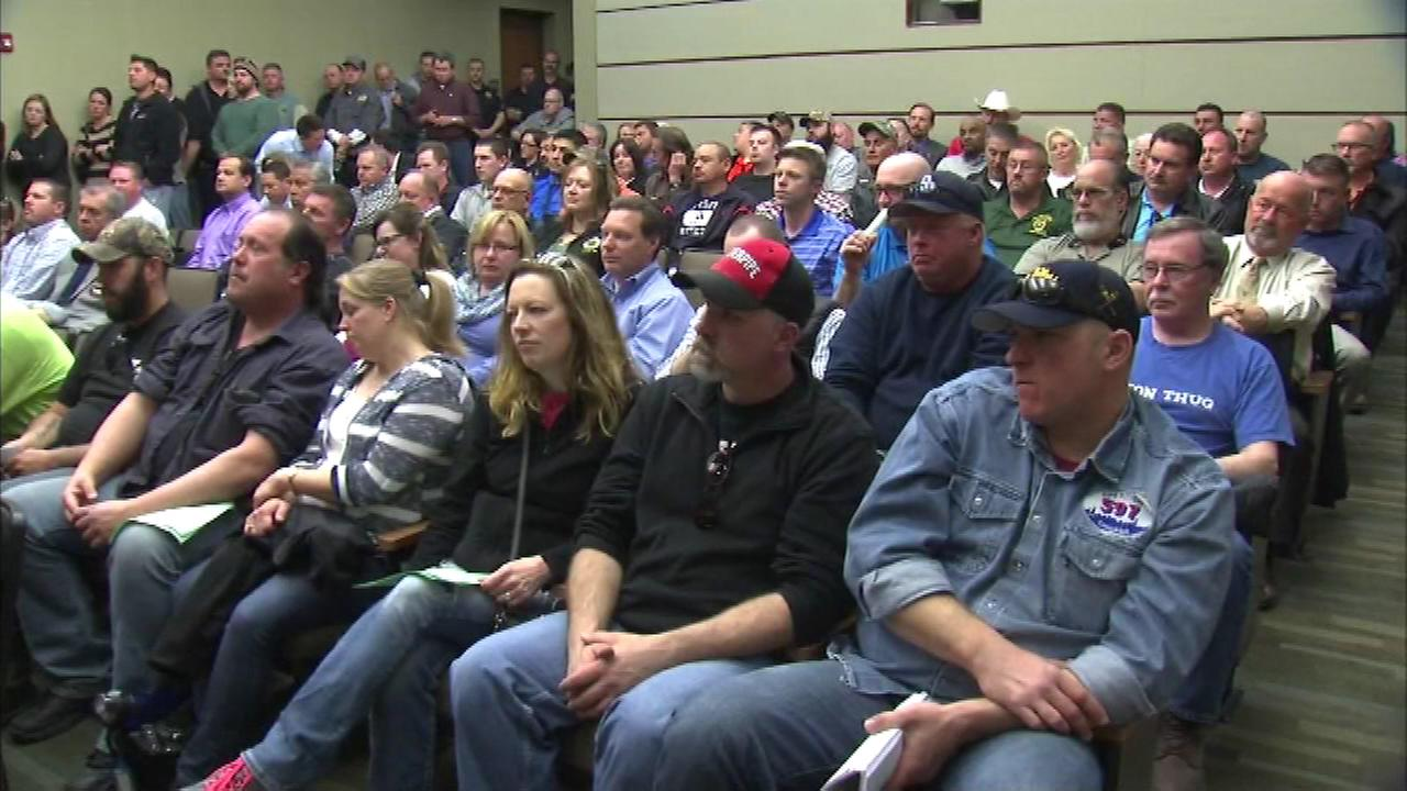 A standing-room-only crowd gathered as the largely pro-union audience gave the Oswego Village Board an earful.