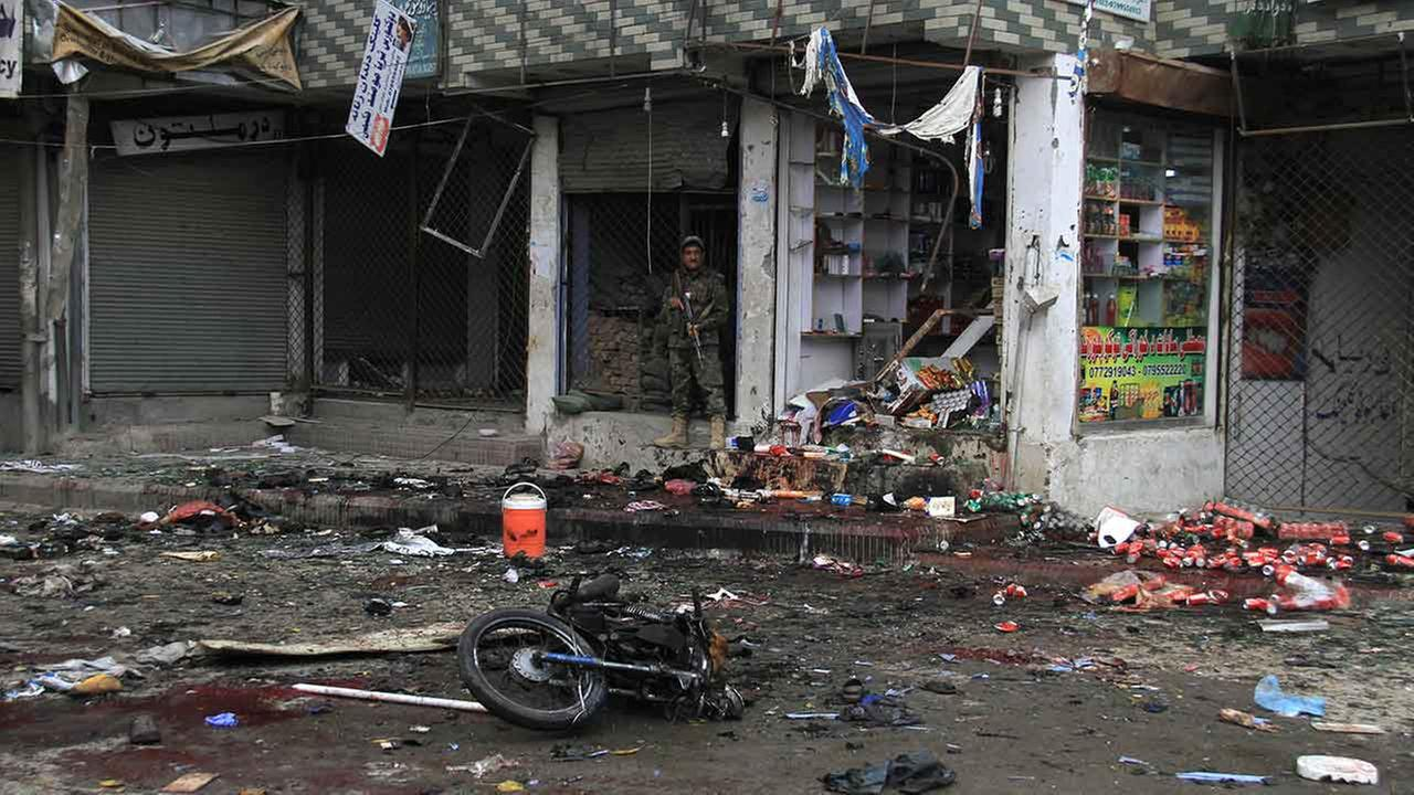 Afghan security forces inspect at the site of suicide attack near to new Kabul Bank in Jalalabad east of Kabul, Afghanistan on April, 18, 2015.