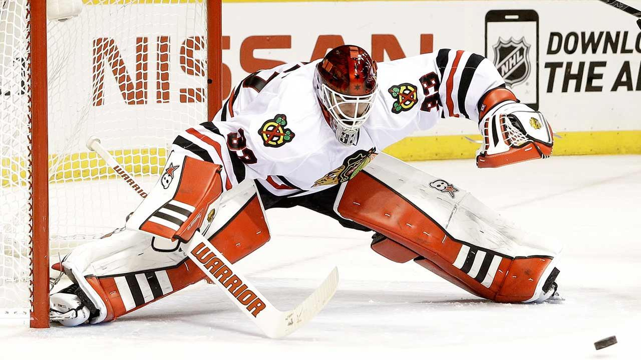 Chicago Blackhawks goalie Scott Darling reaches for the puck in the third period of Game 1 of an NHL Western Conference hockey playoff series against the Nashville Predators.