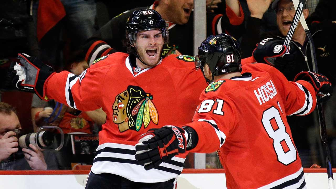 Chicago Blackhawks left wing Brandon Saad, left, celebrates with right wing Marian Hossa after scoring a goal during the second period in Game 3.
