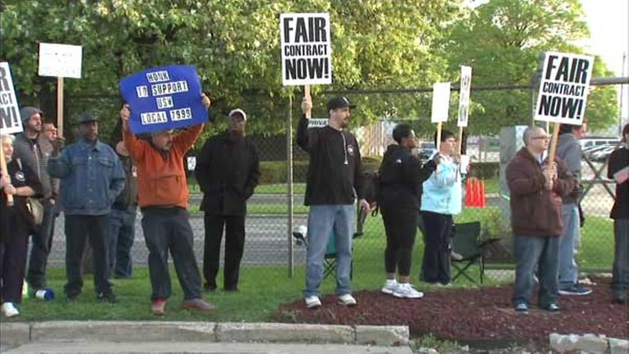 Steel workers strike outside Sloan Valve in Franklin Park