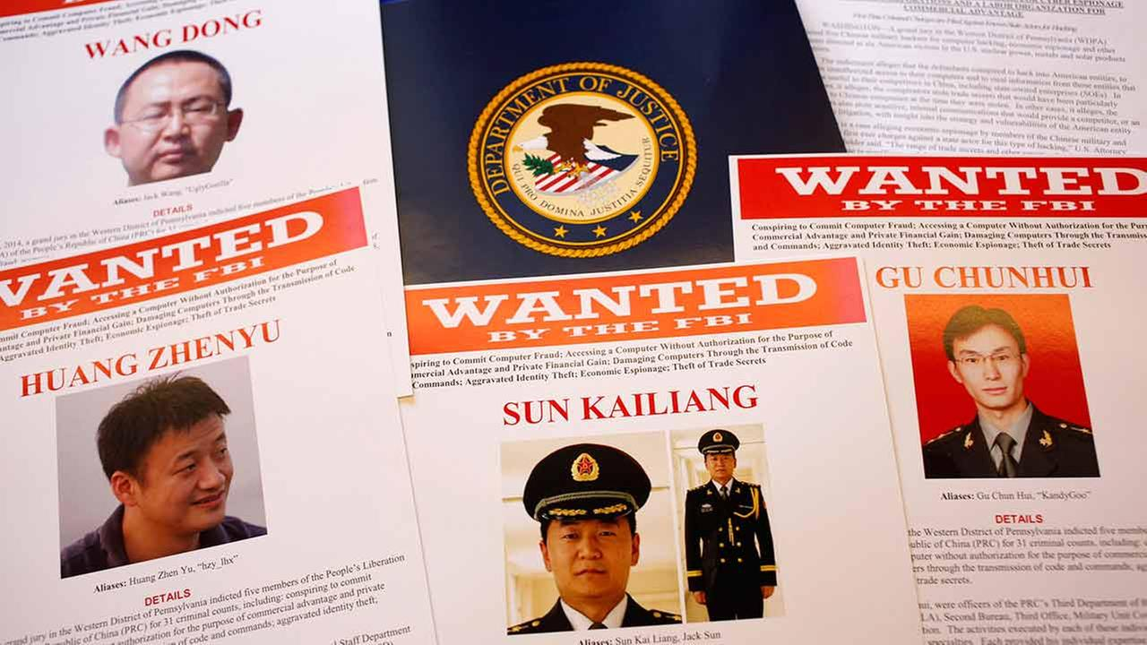 Wanted posters are displayed at the Justice Department in Washington, Monday, May 19, 2014
