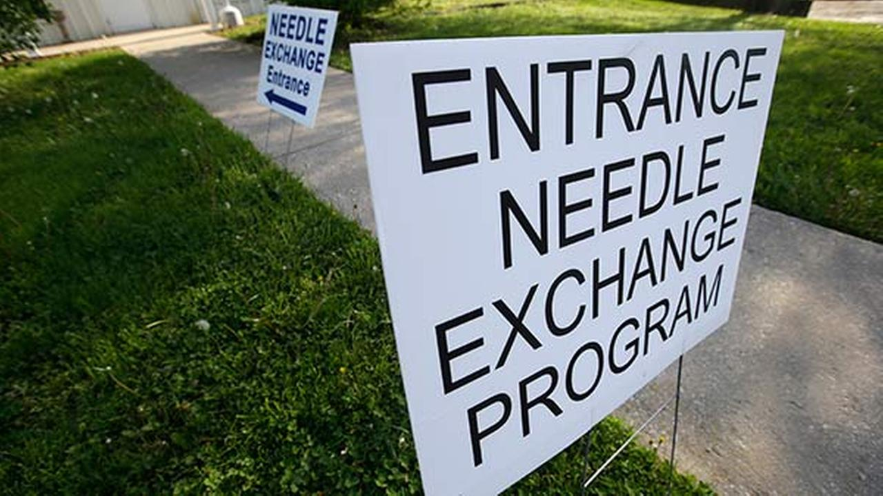 Signs are displayed for the needle exchange program at the Austin Community Outreach Center, Tuesday, April 21, 2015, in Austin, Ind.