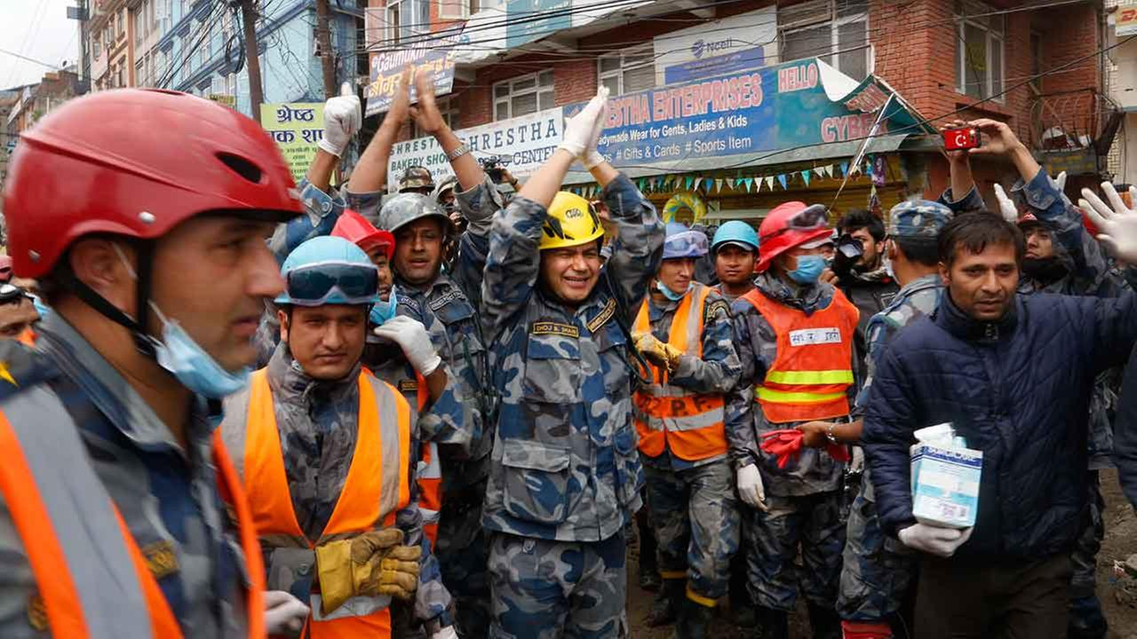 Nepalese policemen cheer.