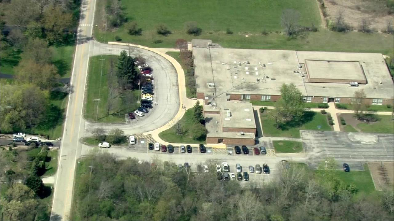 A so-called MacGyver bomb exploded in the parking lot of a school in the suburbs Friday.