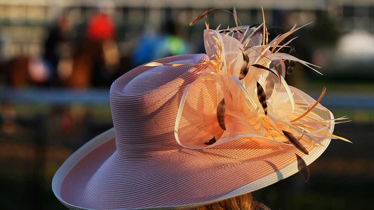 A woman wears a hat during a morning workout for the 141th running of the Kentucky Derby horse race at Churchill Downs on May 1, 2015, in Louisville, Ky.AP Photo/Darron Cummings