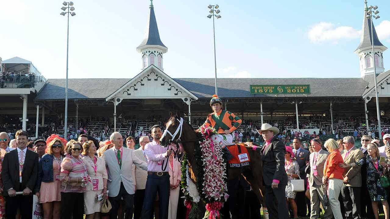 Lovely Maria, ridden by Kerwin Clark, wins the Longines Kentucky Oaks on May 1, 2015, in Louisville, Ky. Photo by Diane Bondareff/Invision for Longines/AP Images