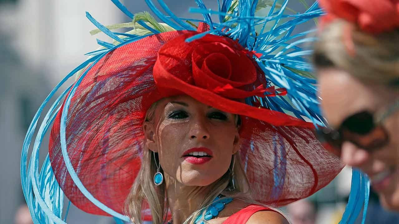 A woman wears a hat before the 141st running of the Kentucky Derby horse race at Churchill Downs on May 2, 2015, in Louisville, Ky.AP Photo/Brynn Anderson