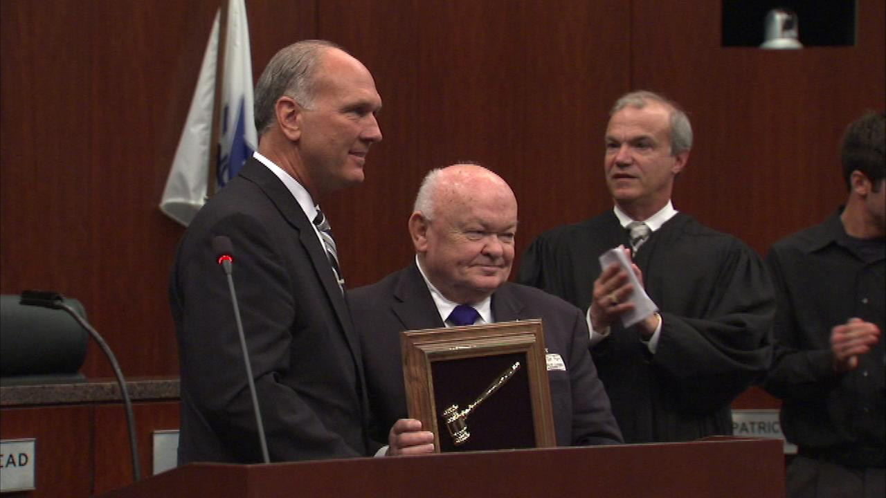New Naperville Mayor Steve Chirico presents a plaque to outgoing Mayor George Pradel.