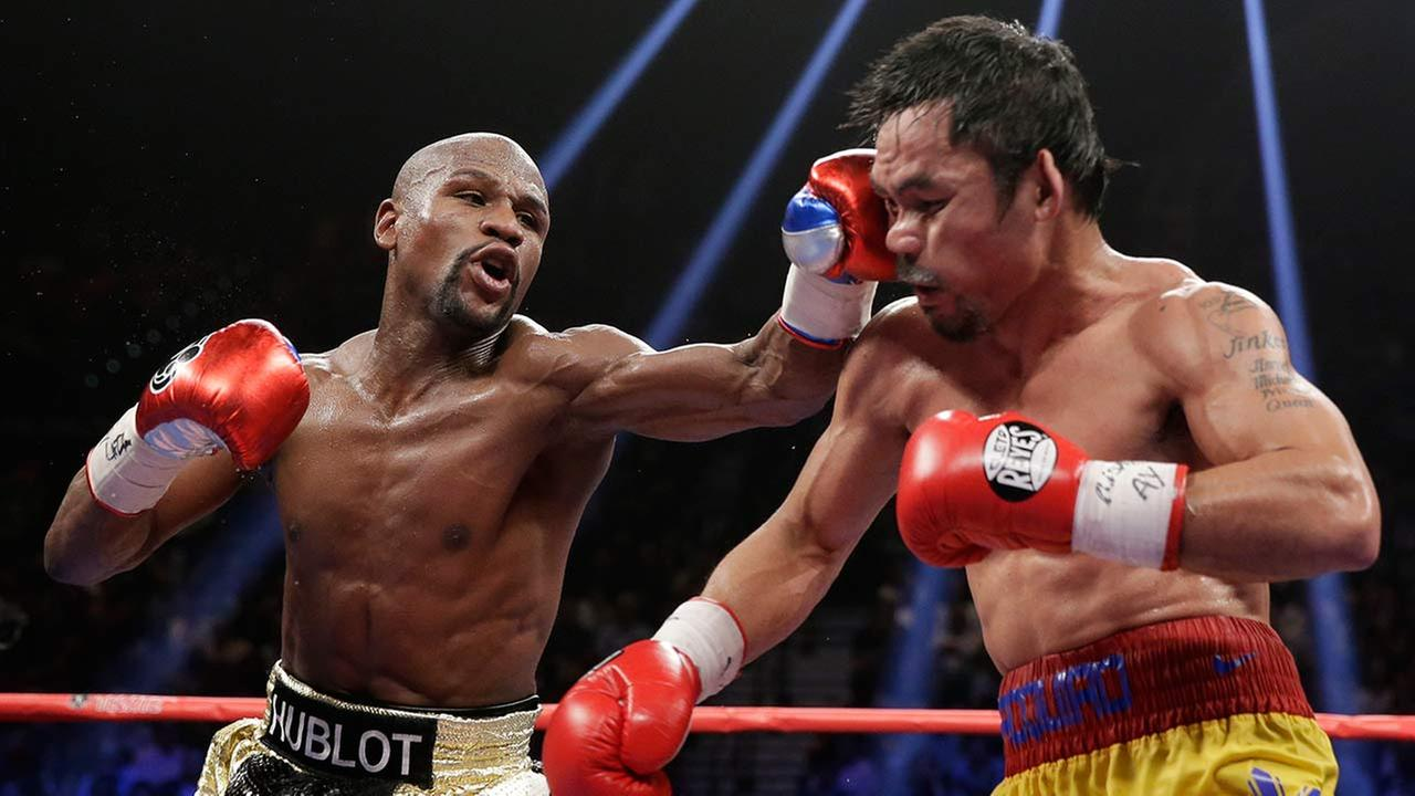 Floyd Mayweather Jr., left, hits Manny Pacquiao, from the Philippines, during their welterweight title fight on May 2, 2015 in Las Vegas.