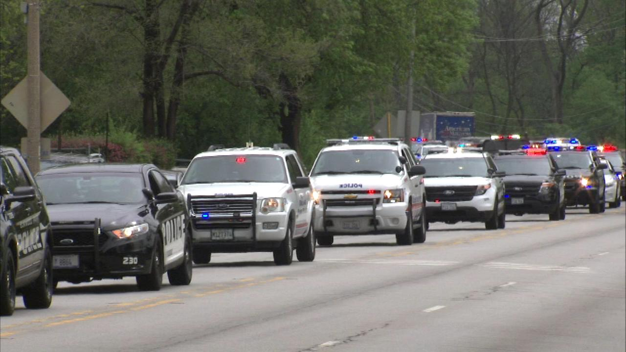 Dozens of police cars from across Cook County took part in a silent motorcade at the start of a memorial for officers killed in the line of duty.