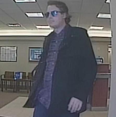 <div class='meta'><div class='origin-logo' data-origin='none'></div><span class='caption-text' data-credit='FBI'>Surveillance images of a man suspected of robbing four suburban banks.</span></div>
