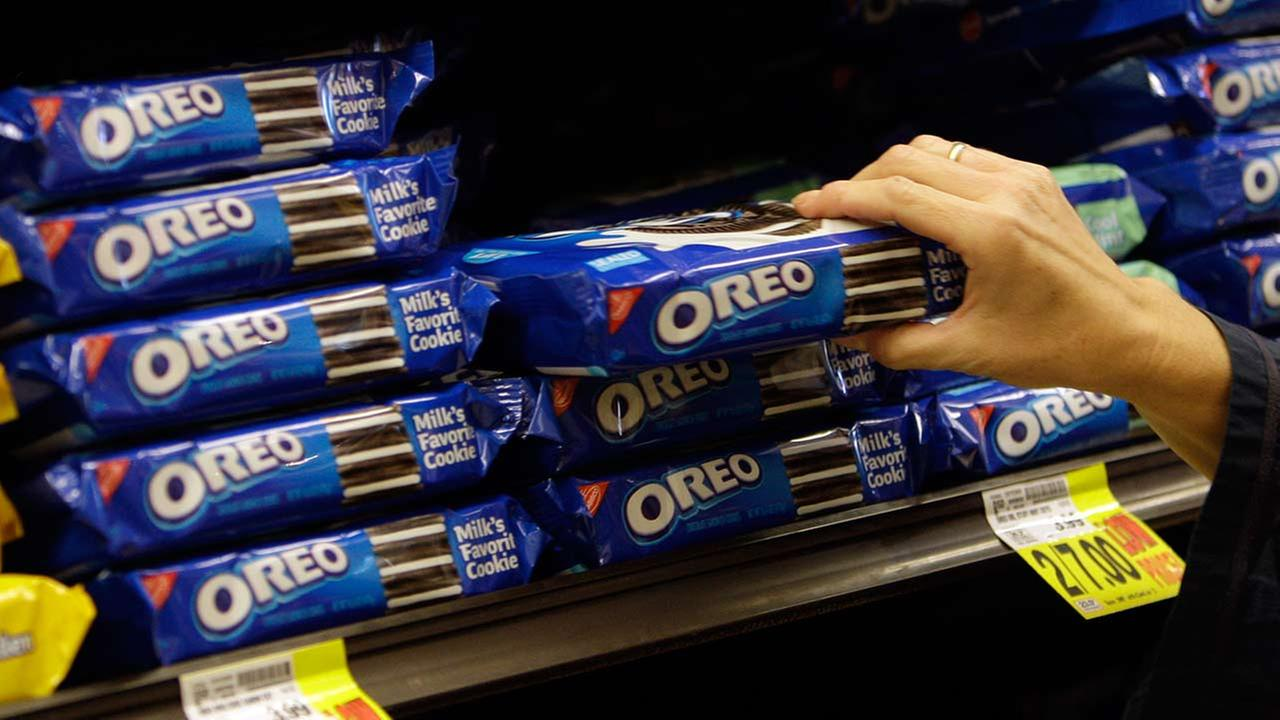 FILE - In this Feb. 9, 2011 file photo, a shopper selects Oreo cookies at a Ralphs Fresh Fare supermarket in Los Angeles.