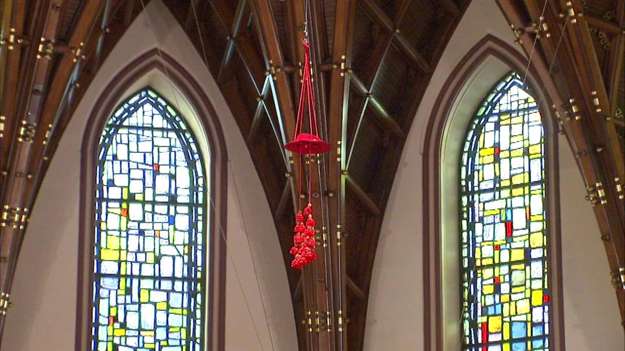 Francis Cardinal Georges red hat, called Galero, is raised to the rafters at Holy Name Cathedral Sunday.